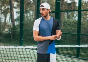 man in tennis clothes
